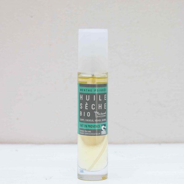 Spray en flacon contenant de l'huile sèche à la menthe poivrée